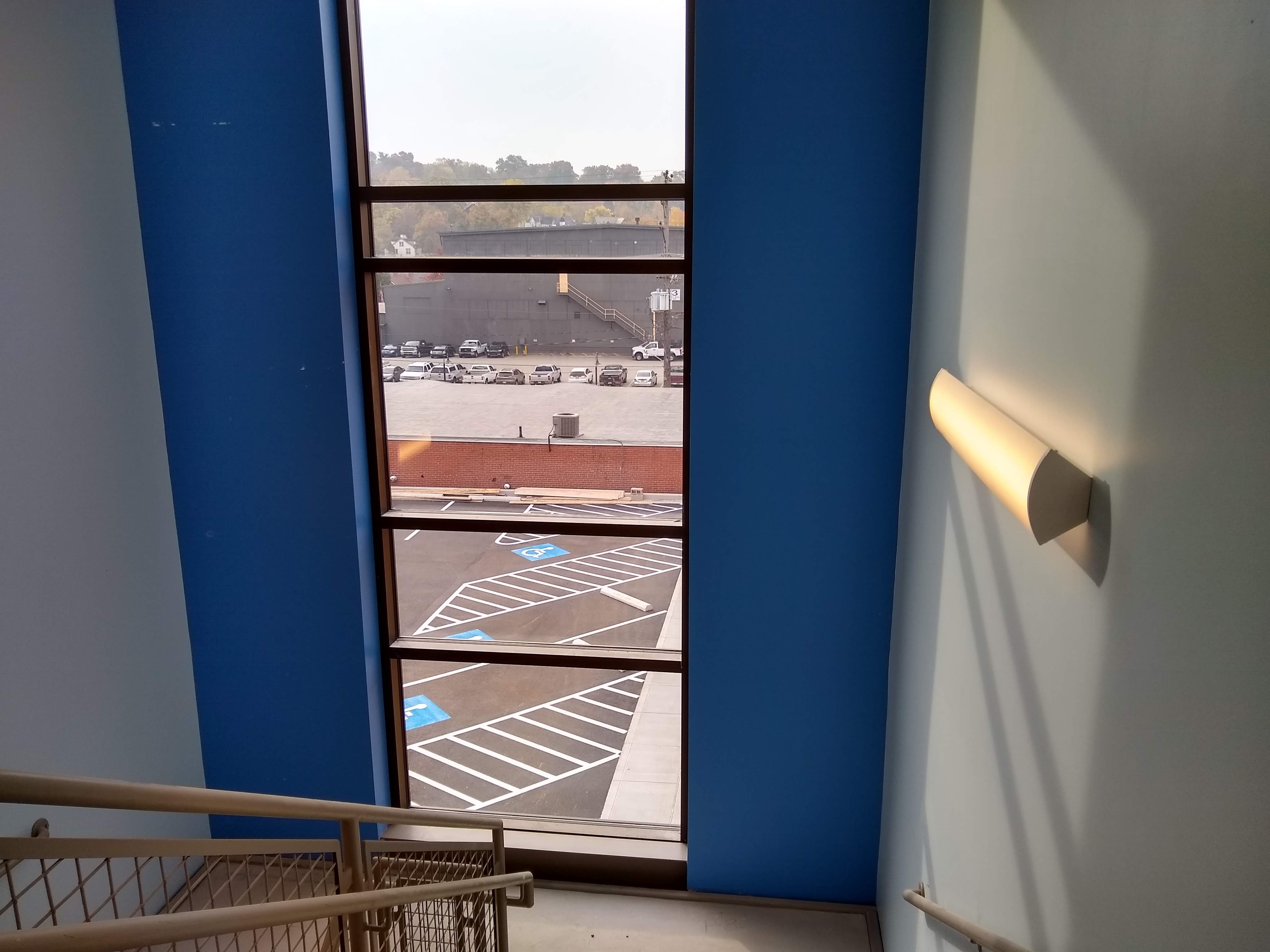 Image of a stair well window looking out into the parking lot