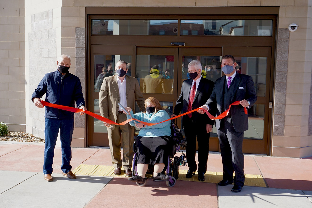 Image of Shona Eakin cutting the ribbon for the grand opening of the new Program and Community Center